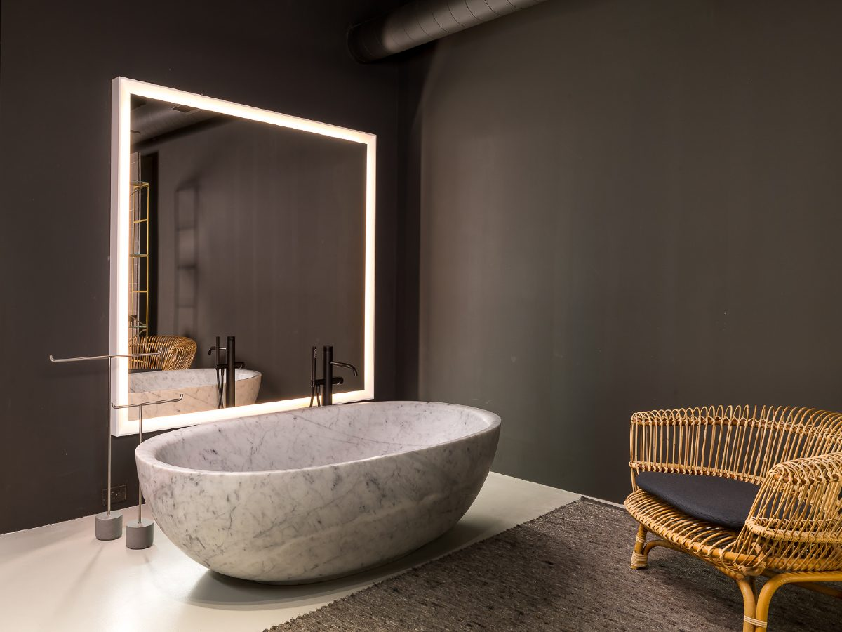 Boffi Showroom Miami marble bathtub and large mirror