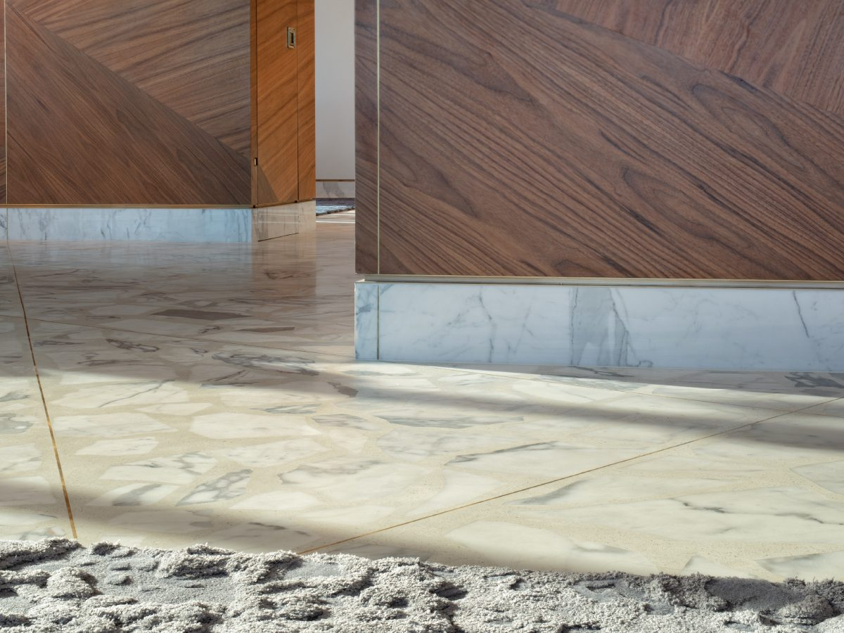 Carillon Miami marble floor and custom wood wall detail