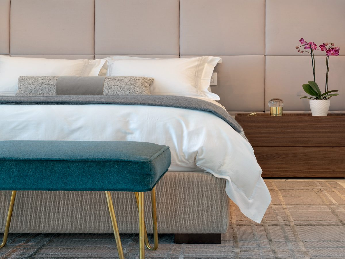 Carillon Miami residence bed with orchid and teal velvet settee