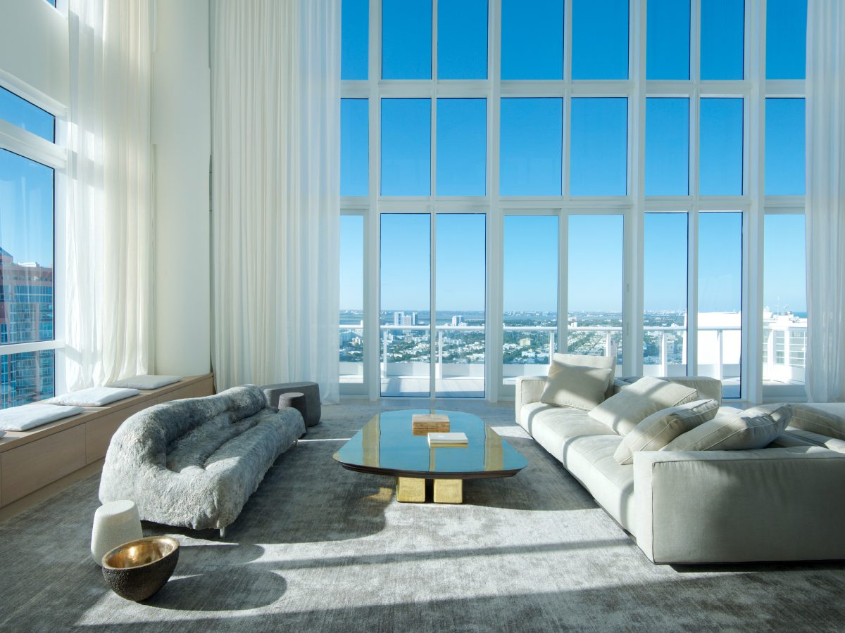 Continuum PH Miami residence living room sofas with city view through floor-to-ceiling windows