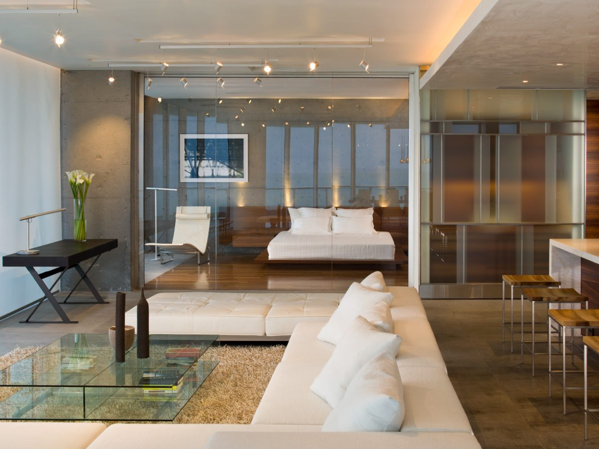 Continuum Miami residence living room with large sectional white couch