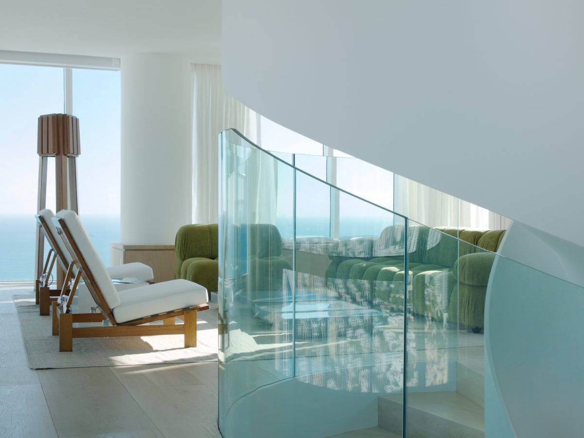 Continuum Miami residence glass staircase with ocean view