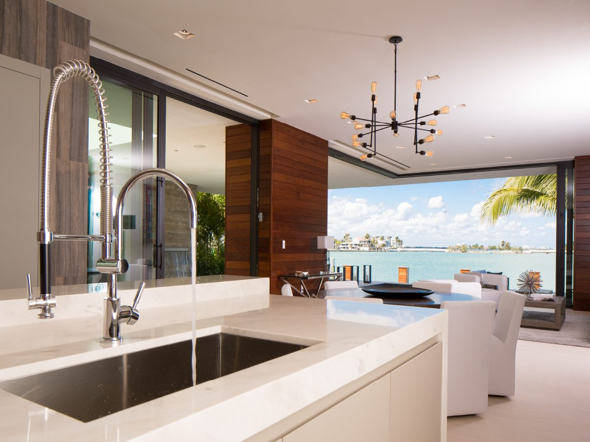 Hibiscus Island Miami residence kitchen with ocean and city view