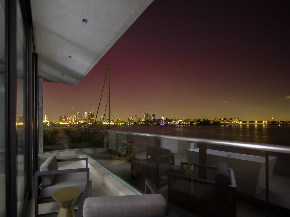 Hibiscus Island Miami residence night view of ocean and city from deck
