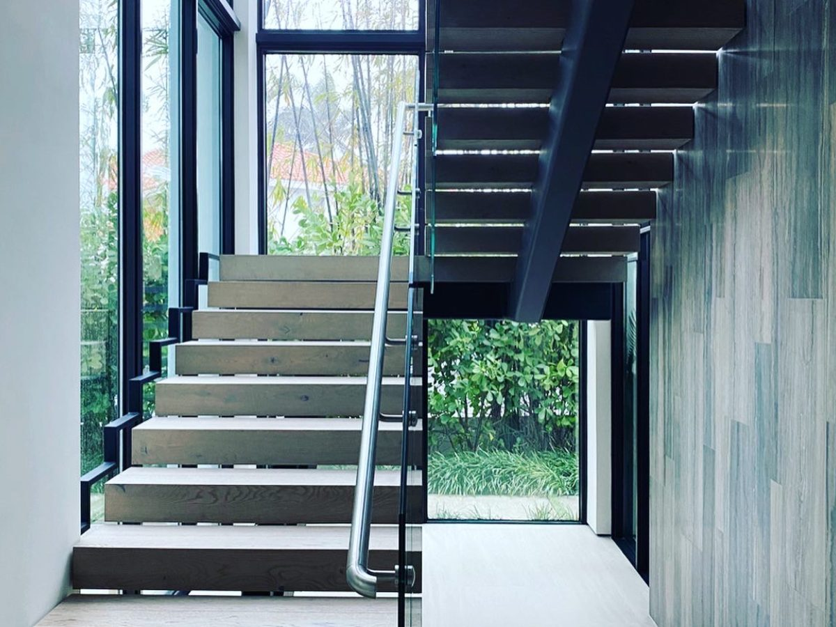 Hibiscus Island Miami residence stairway with floor-to-ceiling window view