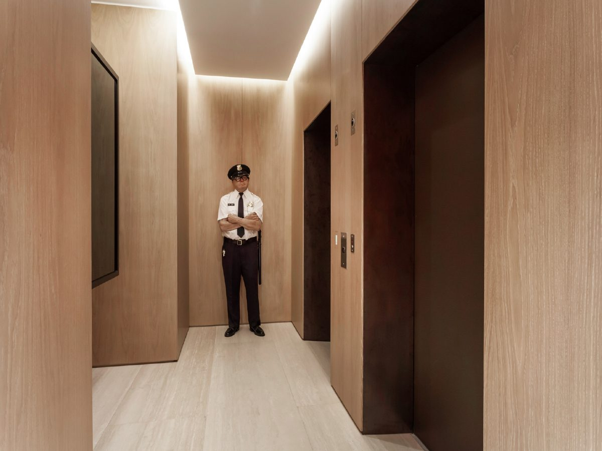 Continuum North Miami private residence hallway with wax statue of a security guard