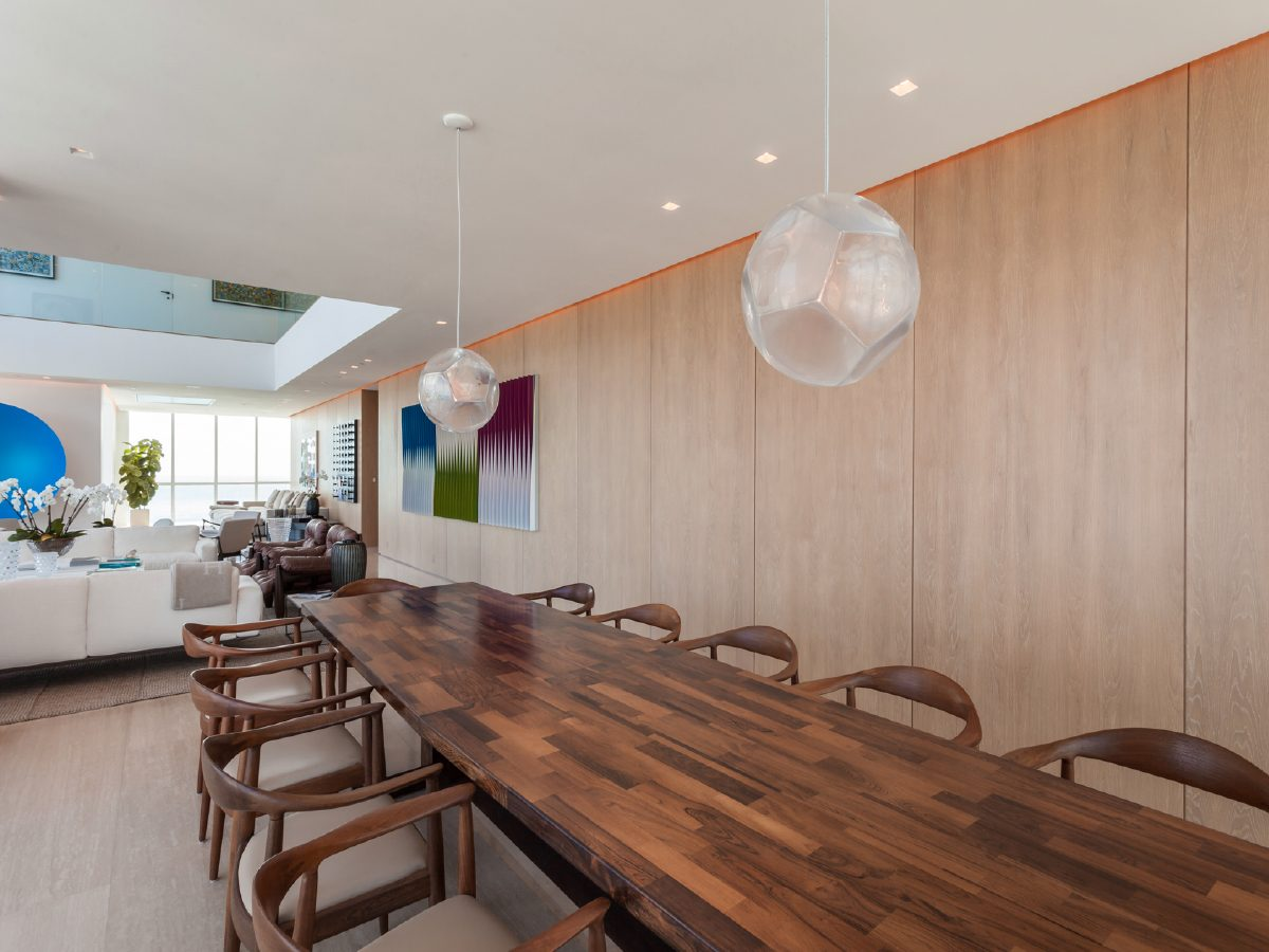 Continuum Miami Private PH Residence long wood dining table and chairs