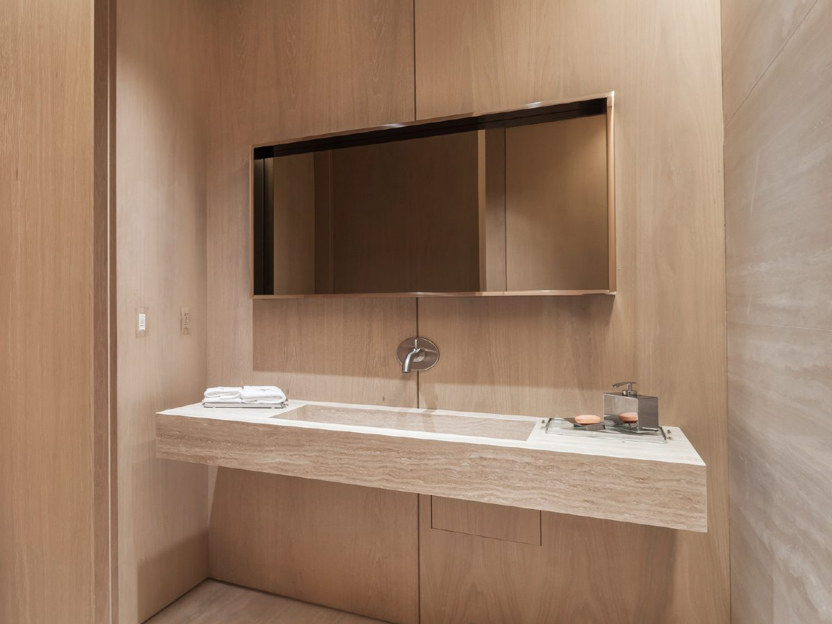 Continuum North Miami private residence bathroom vanity, all in light marble