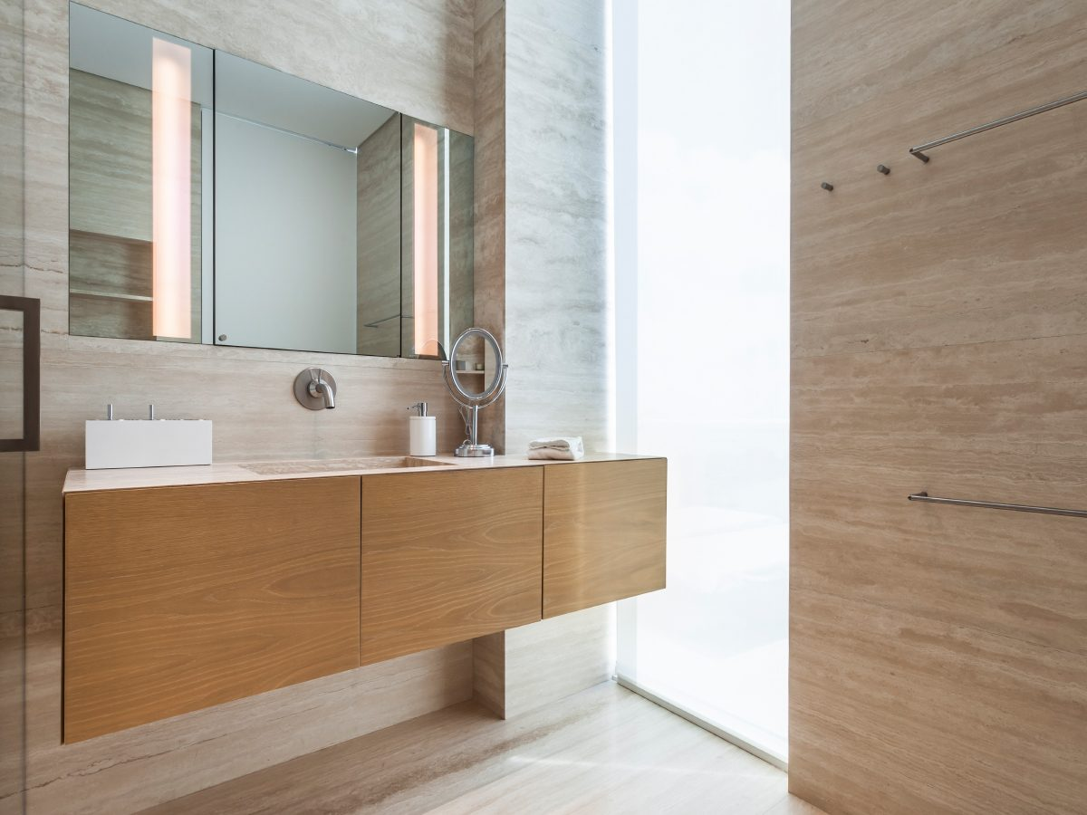 Continuum Miami Private PH Residence wood vanity and marble bathroom
