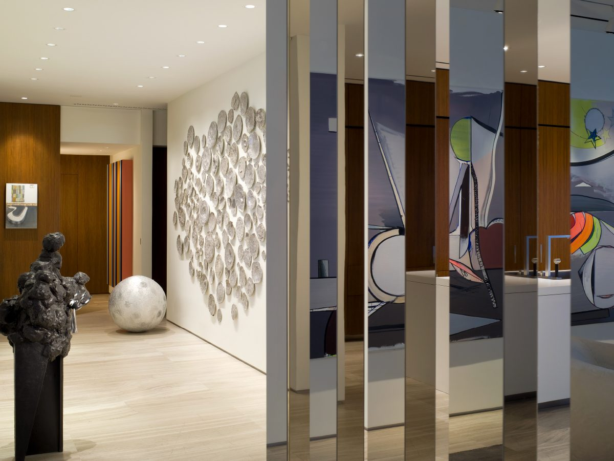 Apogee Miami residence hallway mirror and colorful wall art