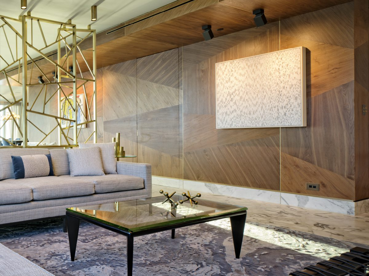 Carillon Miami residence living room with custom wood walls and brass sculpture
