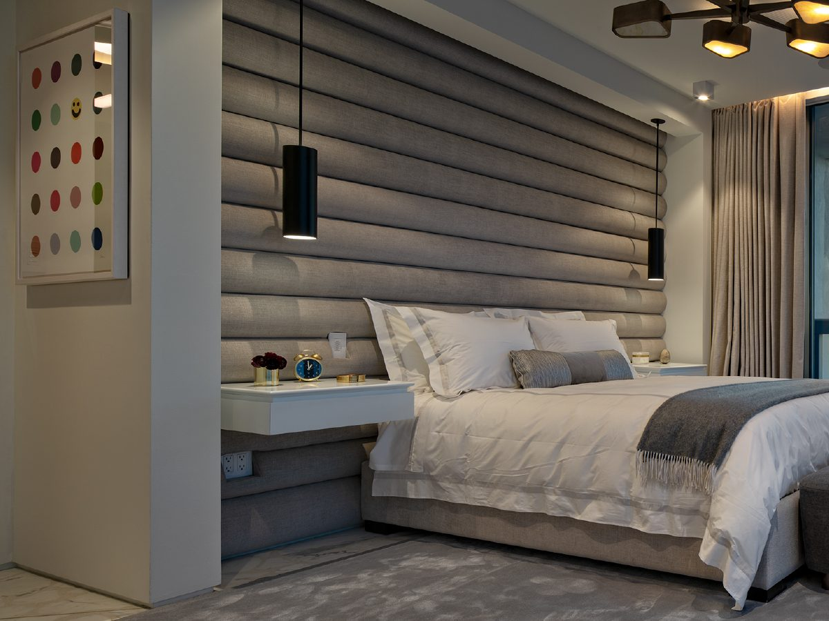 Carillon Miami residence bedroom and wall-sized headboard