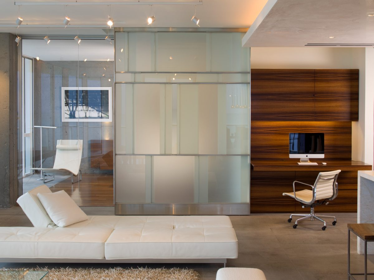 Continuum Miami residence bedroom with glass wall