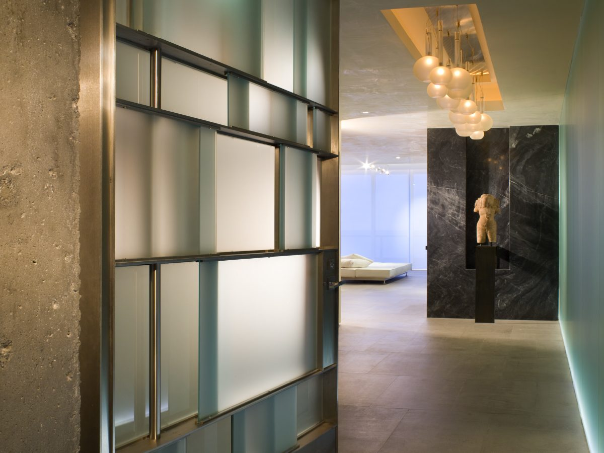 Continuum Miami residence hallway floor-to-ceiling glass panels
