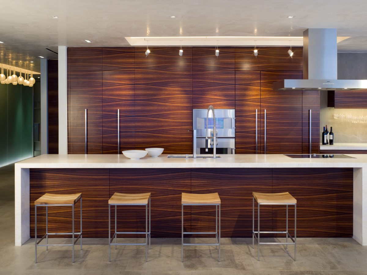 Continuum Miami residence kitchen bar with wood floor-to-ceiling backdrop