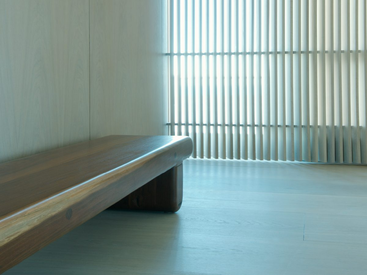 Continuum PH Miami residence smooth wood bench in hallway