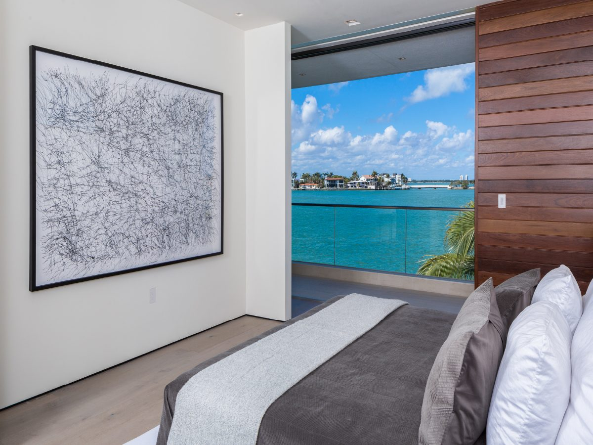 Hibiscus Island Miami residence bedroom with view of the water